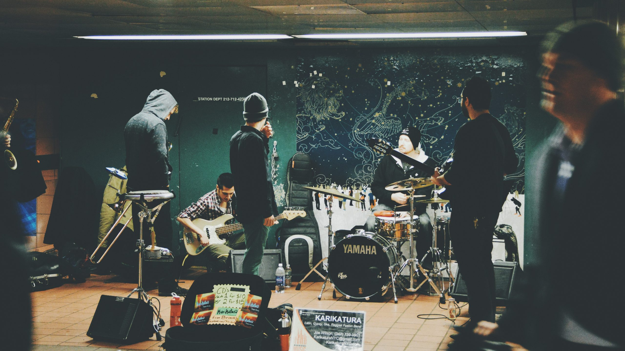 Local Band playing a show photographed by Hans Vivek sourced off of unsplash
