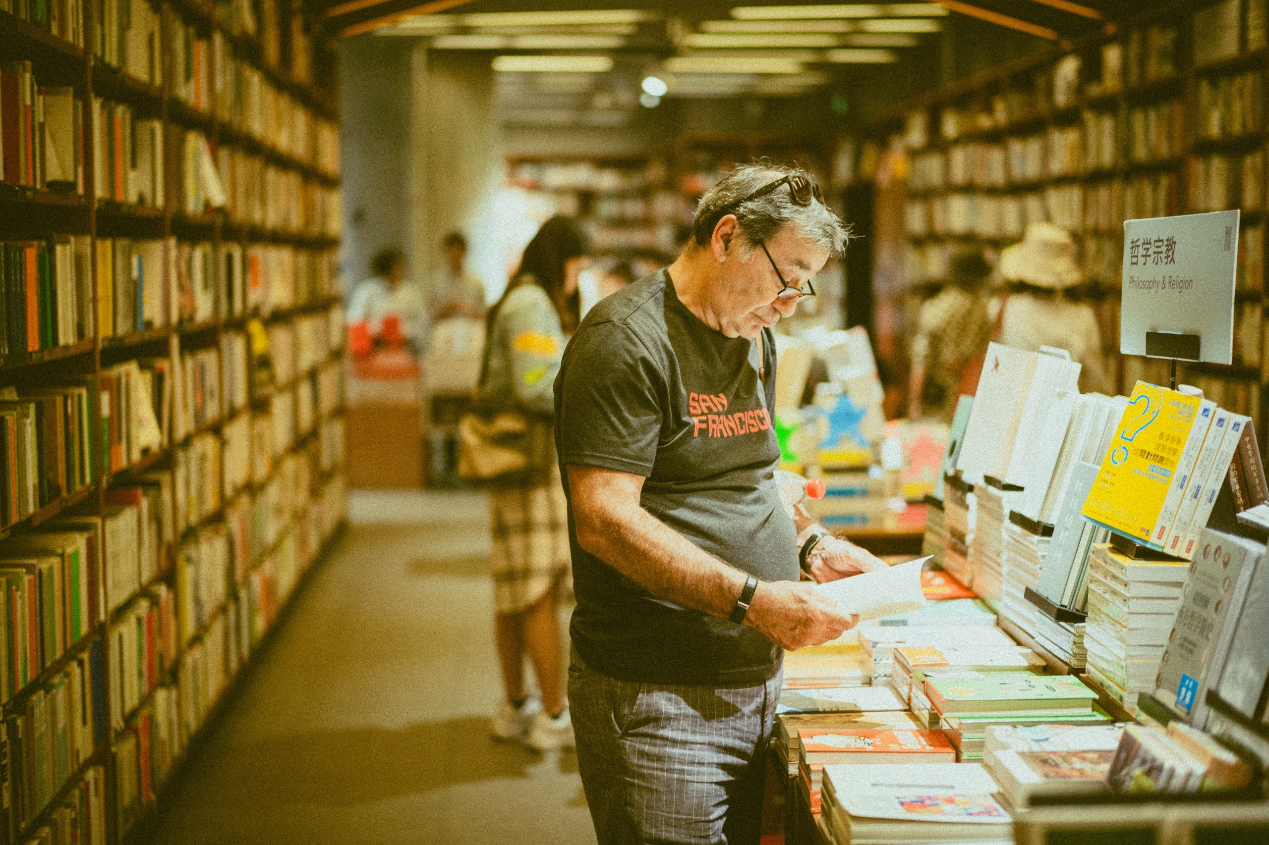 Man Shopping In Record Store Photographed by Kenny Luo found on Unsplash