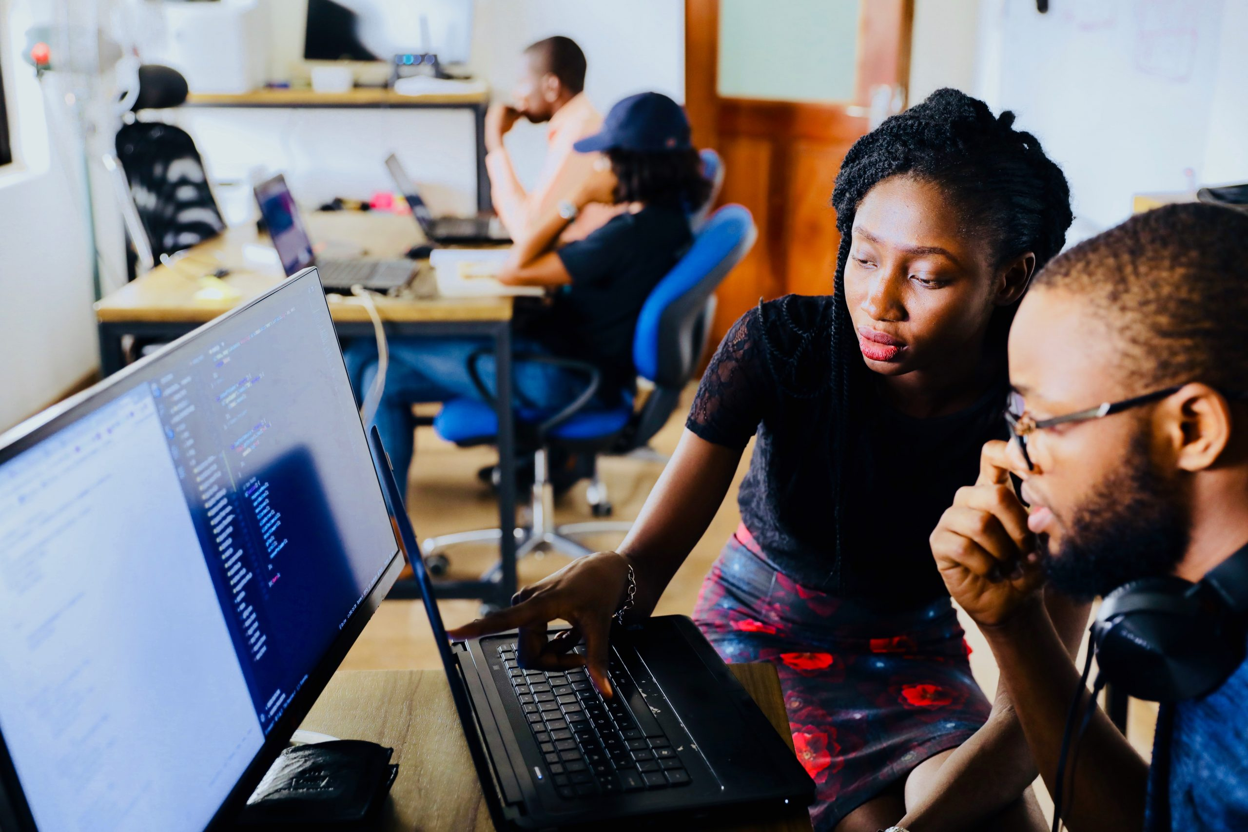 2 People working together on startup business project photographed by Nesa by Makers sourced off of Unsplash